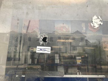 A bullet hole outside Eat and Take Food left from an Easter Sunday shooting. (Caitlin Mota   The Jersey Journal)