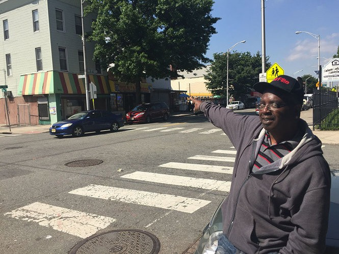 Jersey City man Gary Jones points out the faded street signs that line Martin Luther King Drive.