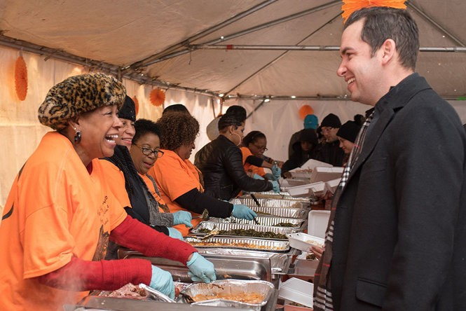 Cunningham and Fulop share a laugh as Cunningham volunteers at an annual free Thanksgiving dinner hosted by Monique's Techniques in Jersey City in 2016.