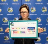 Oksana Zaharov of Edgewater won $5 million with a lucky $10 scratch-off ticket she bought in Manhattan. (New York Lottery)