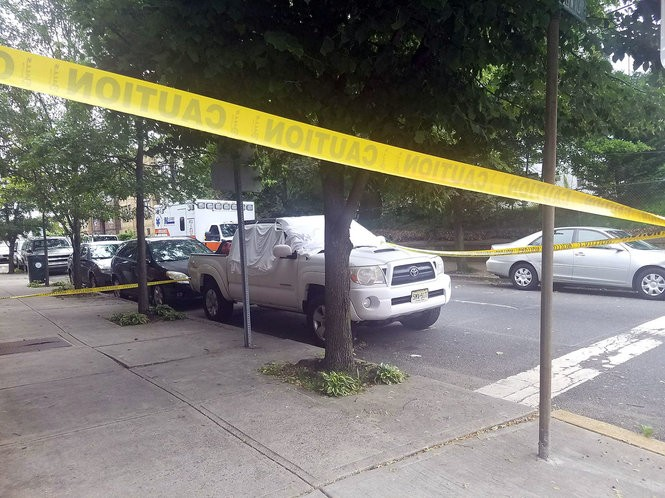 A pickup truck on West 24th Street in Bayonne in which a body was found on Thursday morning, May 31, 2018. (Tony Campano photo)