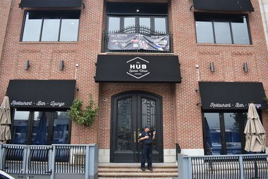 A Hoboken police officer stands outside the HUB Hoboken, a popular Hudson Place bar that was charged with multiple counts by the city's Alcoholic Beverage Control Board.