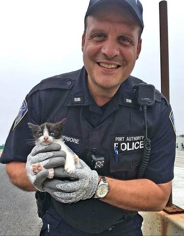 Port Authority Police Officer Nunzio DelPriore with his new friend Bridgette. Port Authority PBA photo