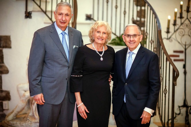 Joseph A. Panepinto, left, his wife Stefania and Eugene J. Cornaccia, president of Saint Peter's University are seen at the SPU President's Reception Oct. 11, 2018, after Panepinto donated $10 million to the school. (Saint Peter's University photo)