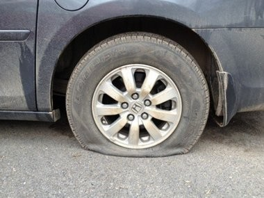 Will a bottle of goo fix this flat? If not, you're in for a long trip behind a tow truck.