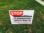 Those opposed to the redevelopment of the Union Hotel have placed signs in their front yards, like this one in front of a Spring Street residence. (NJ Advance Media file photo)