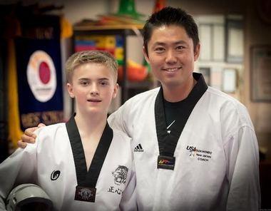 Head Master Sae Jang (owner of JSK Taekwondo Martial arts. Flemington) received notice from KUKKIWON (World Taekwondo headquarter) of promotion of the 6th Dan senior master degree. Pictured is Kyle Gillard (JSK's Black Belt student) and Master Sae Jang (JSK Head Master). (courtesy photo)