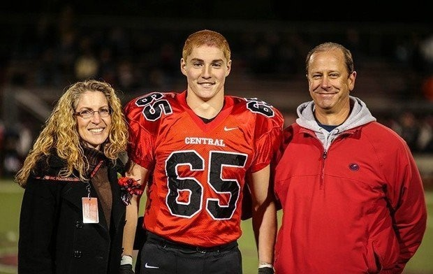 Timothy Piazza, center, with his parents