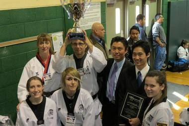 JSK Taekwondo Academy captured 11 medals during the New Jersey State Championships. Front row, from left â Mandy Dietze, Victoria Golczewski, Lauren Atkinson; back row â Candace Antkies, Dariusz Golczewski, Head Master Sae Jang, Master Richard Gerstner