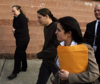 Deborah Campbell, left, and her husband, Heath Campbell, leave the courthouse with law clerk Georgina Palitto after appearing in family court in Hunterdon County in this 2009 file photo.