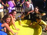 """Julia MacIsaac, Jonatha Berg, Paxton Gold, Harvey Gold, Jaimee Gold and Declan Gold make handprints symbolizing """"something they want to do in the New Year 5774"""" during Or Chadash's Rosh Hashanah Children's services."""