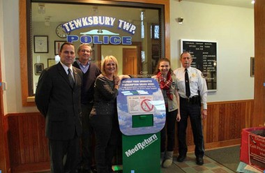 A permanent prescription disposal box has been installed at the Tewksbury Township Police Department. On hand to dedicate the new box are (from left) John Kuczynski, chief of detectives of the Hunterdon County Prosecutor's Office; Tewksbury Township Administrator Jesse Landon; Lesley Gabel, project director of the Safe Communities Coalition; Allie Obszanski, a sophomore at Voorhees High School who initiated this project for her Girl Scout Gold Award; and Tewksbury Township Police Chief Thomas Holmes.