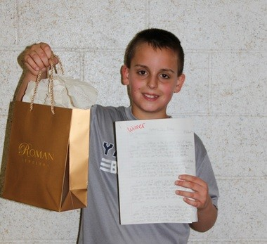 Kyle Schuddeboom shows off his prize.