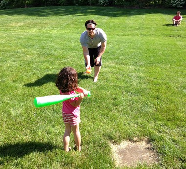 Abbey, 4, gets her turn at bat before a family game of softball nearly became a tragedy. Abbey fell into a septic tank after chasing a hit ball.