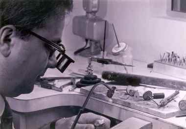 Roman Shor works in his shop during the early days of Roman Jewelers.