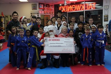 Pictured: JSK Tae Kwon Do School in Flemington Head Master Sae H.Jang and his students have once again shown community support. The JSK Tae Kwon Do has donated $1000 to the Hunterdon Medical Center Pediatric Department. (courtesy photo)