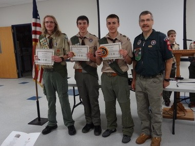 Scoutmaster Emeritus Tom Lawrence of Boy Scout Troop 200, Annandale, had the honor of presenting The Triple Crown of National High Adventure Award to scouts Michael Marosy, David Wells and Andrew Wells on Feb. 23. Pictured (from left) is: Michael Marosy, David Wells, Andrew Wells and Scoutmaster Emeritus Tom Lawrence. (courtesy photo)