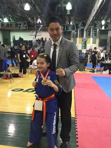 Twenty-five students of JSK Taekwondo Martial Arts Academy in Flemington attended the annual New Jersey 2015 Big East Taewkondo Tournament at Ridge High in Bernards Townships on April 26. Pictured (from left) is gold medalist Mia Moskovciak with Master Sae Jang. (courtesy photo)