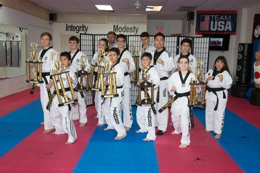 A Black Belt Tea ceremony was held at JSK Taekwondo Martial Arts Academy in Flemington last on June, 6. Pictured is Master Sae H. Jang, the head instructor at JSK and Black Belt members. (courtesy photo)