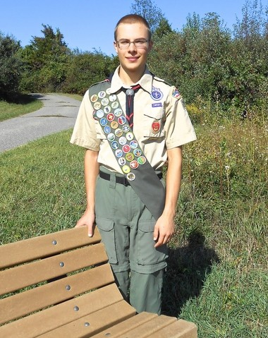 Nathan Sferra of Union Township was honored for earning the rank of Eagle Scout at a Court of Honor ceremony held on June 25, at the Bethlehem Presbyterian Church in Pittstown. Nathan is pictured with one of the four benches installed at Hoffman Park. (courtesy photo Karen Sferra)