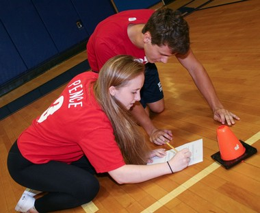 Morgan Middleberg and Jack Willard tackle sheet of problems in the mathematics round of the Del Val High School 'Senior' Olympics.