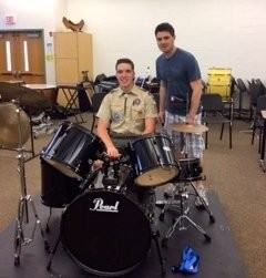 Eagle Scout candidate John Anderson is pictured with Clinton Township Middle School Instrumental Music Director, Stephen Schaefer. John and Scouts from Troop 200 built the drum kit riser as part of his Eagle Scout Project. (courtesy photo)