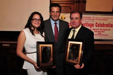 Essex County Executive Joseph N. DiVincenzo, Jr. (center) presented the Star of Essex Awards to Eliana Pintor Marin, member of the Newark Public Schools Advisory Board, and John M. Soares, Director of Operations for the Ironbound Soccer Club, during the annual Essex County Portuguese Heritage Celebration on Wednesday, July 31. The honorees were recognized for their many positive contributions to the history of New Jersey and dedication to youth, especially in Essex County. (Photo by Glen Frieson)