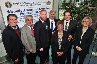 Essex County Executive Joseph N. DiVincenzo, Jr. (second from right) along with (from left) Vince Papale, Eagles Special Team's Captain and Sheriff Armando Fontoura; former Navy Hospital Corpsman Bobby Donnelly from the Wounded Warrior Amputee Football Team; Jim Burt, two-time Super Bowl champion; Freeholder President Blonnie Watson and Freeholder Vice President Patricia Sebold. (Photo by Glen Frieson)