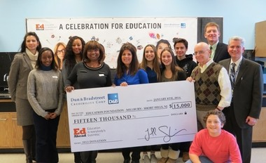Millburn Middle School, representatives from Dun & Bradstreet Credibility Corp.'s New York office presented a âcheckâ representing the grant of $15,000 received by the Education Foundation of Millburn-Short Hills to fund STEM programs at Millburn Middle School. Front row: Dorothy Kiniti, D&B marketing manager; Brenda Gary, D&B VP marketing operations; Amy Talbert, president, Education Foundation of Millburn-Short Hills; students, Amanda Cohen, Emma Boruchov; teacher, Lester Greenberg; and Millburn Principal Michael Cahill. Back row, Dr. Christine Burton, Trenice Taylor, D&B marketing manager; student, Evan Bitan; and Dr. James A. Crisfield. Kneeling: student, Davis Moshier.