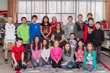 Pictured here with the students is author Lauren Tarshis.