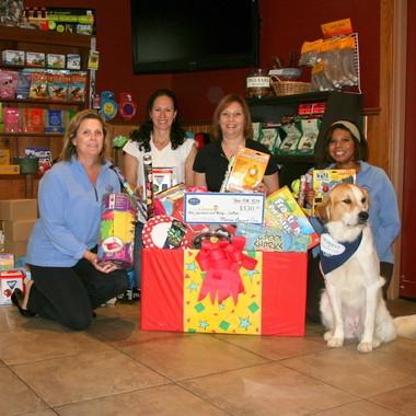 Pictured (from left) are: Joanne Morris; Stacy Bergerman, president of The Birthday Box; Jenn Wilner, vice president of The Birthday Box; Debora Montgomery, marketing manager of Morris Animal Inn; and Lexi.