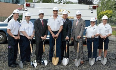 Volunteers of the Summit Volunteer Rescue Squad along with Alan Lieber, President of Overlook Hospital, and Kevin Cummings, President/CEO of Investors Bank, gathered to break ground at the new home for the Rescue Squad. Located on Elm Street in Summit, the new facility will have approximately 20,000 square feet of space, nearly four times the space of the previous Rescue Squad headquarters. The additional space will house ample garage facilities for the emergency vehicles, as well as a locker room, sleeping and training areas. The new facility was made possible through donations from local residents and generous contributions from both Overlook Hospital and Investors Bank. During the construction of the new building, the squad will operate out of temporary facilities generously offered by the Salerno Duane car dealership. Pictured (from left) are Steve Mortenson, Carl Ganger, Alan Lieber, John Christman, Kevin Cummings, Joseph Stefans, Kari Phair, Kenneth Herr.