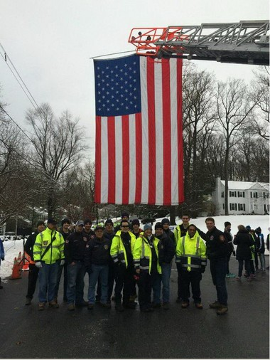 Stephanie Krauss of Strong Designs gets extra credit for 'literally sewing the flag in the middle of the night' so firefighters could display it at the Thanksgiving Day turkey trot. (courtesy photo)
