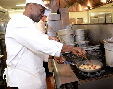 Culinary Arts student Winston Gibson cooks a chicken, shrimp and scallops aurora in the kitchen of The Back Door Café at Camden County Technical School. (Staff Photo by Joe Warner/South Jersey Times)