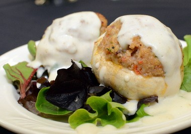 Jumbo mushrooms stuffed with mild sausage served with a Mornay sauce at Camden County Technical School's Back Door Café. (Staff Photo by Joe Warner/South Jersey Times)