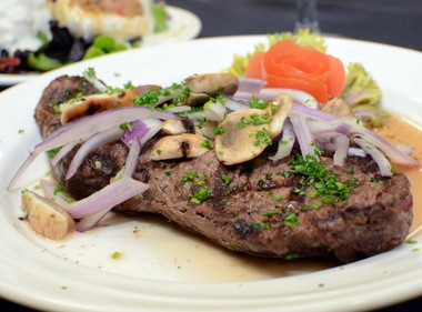 Broiled New York strip steak with sauteed wild mushrooms at Camden County Technical School's Back Door Café. (Staff Photo by Joe Warner/South Jersey Times)