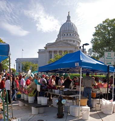 A stall at the Farmer's Market in Madison, Wisc., with the Capitol in the background, is shown above.