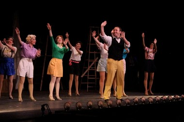 The cast of '42nd Street' is shown performing in a scene from the musical at the Broadway Theatre of Pitman.