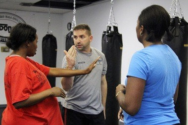 Don Melnick of Israeli Krav Maga teaching self defense to class participants.