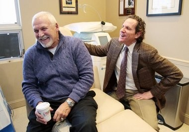 Former Philadelphia Flyer Bernie Parent, left, talks about his Cool Sculpting procedure with Dr. Steven L. Davis, right, at Davis Cosmetic Surgery in Cherry Hill, Monday, Jan. 19, 2015. (Tim Hawk   South Jersey Times)