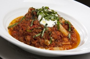Elbow macaroni and beef bolognese topped with sheep's milk ricotta.