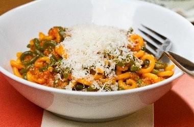 Gramigna pasta with pork sausage ragu, tomato and black pepper.