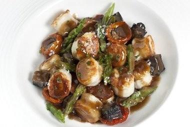 Ricotta gnocchi, asparagus, tomato confit, portobello mushroom and Parmesan butter.