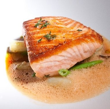 Salmon with haricots verts, eggplant and tomato-fennel broth.