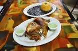 Aji salsa offers a bit of a kick to rotisserie chicken, with yellow rice and black beans, at Uncle Paulie's Puro Sabor.