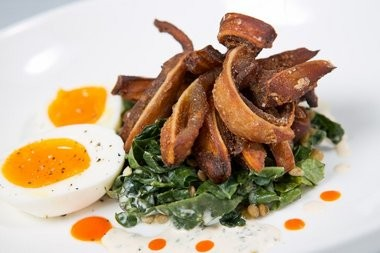 Pigs' ears, served with Tuscan kale, lentils and eggs