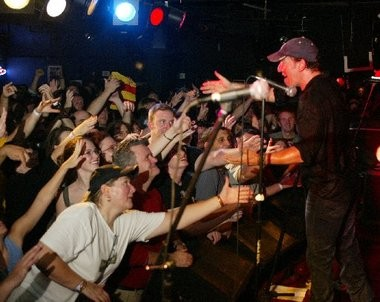 The Boss greets audience members after playing during the 2003 Light of Day benefit concert at the Asbury Park rock club.