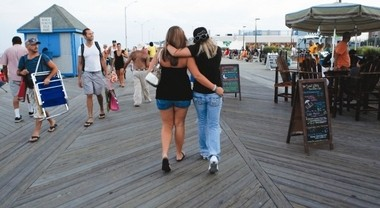 Visitors stroll the Asbury Park boardwalk.