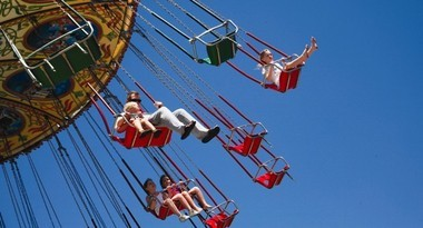 The swing has riders sailing in the air above the Point Pleasant Beach boardwalk.