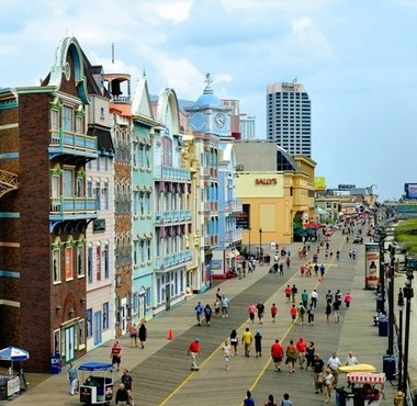 Colorful buildings and sleek casinos line the Boardwalk in Atlantic City.